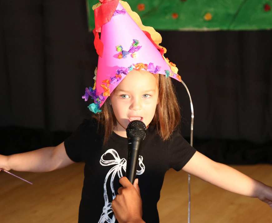 Karaoke for kids during Jungle Beats birthday parties at the Salsa With Silvia dance studio.