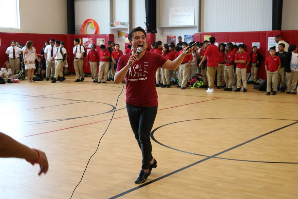 Instructor Mario from the Salsa With Silvia dance studio teaches after school programs and performs and teaches salsa at schools.